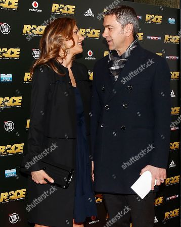 """Martina Colombari, left, with her husband Alessandro Costacurta pose for photographers on the occasion of the red carpet for the movie """" Race"""" in Milan, Italy"""