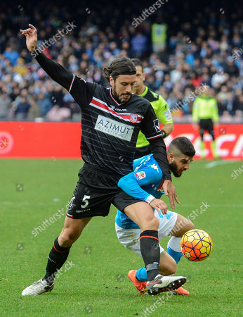 Napoli's Lornezo Insigne, right, and Carpi's Cristian Zaccardo challenge for the ball during a Serie A soccer match between Napoli and Carpi, at the San Paolo stadium in Naples, Italy
