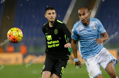 Hellas Verona's Leandro Greco, left and Lazio's Abdoulay Konko vie for the ball during a Serie A soccer match between Lazio and Hellas Verona at Rome's Olympic stadium