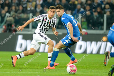 Stock Photo of Juventus' Paulo Dybala, left, challenges the ball with Sassuolo' Luca Antei during a Serie A soccer match between Juventus and Sassuolo at the Juventus stadium, in Turin, Italy