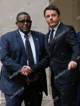 Stock Image of Italian Premier Matteo Renzi, right, shakes hands with Somali Prime Minister Omar Abdirashid Ali Sharmarke during their meeting at Chigi palace Premier's office, in Rome