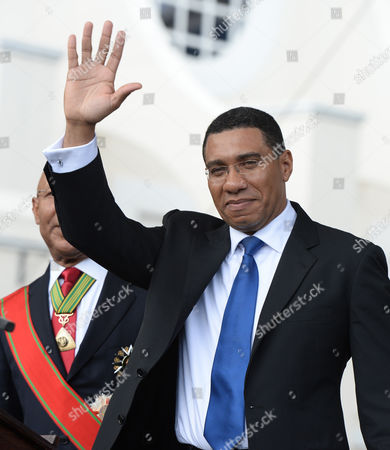 Stock Image of Andrew Holness Andrew Holness, Jamaica's new Prime Minister waves to the crowd after being sworn in by Governor General Sir Patrick Allen, left, in Kingston, Jamaica, . Holness was elected with a slim-margin victory over then Prime Minister Portia Simpson-Miller of the People's National Party