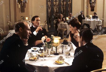 Stephan Grothgar, Charles Dance, Phyllis Logan and Christoph Waltz in a scene from 'Goldeneye' - 1989