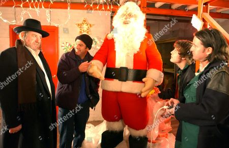 David Fleeshman and Robson Green in a scene from 'Christmas Lights' - 2004