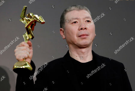 Feng Xiaogang Chinese director Feng Xiaogang poses after winning the 10th Anniversary Special award of the Asian Film Awards in Macau