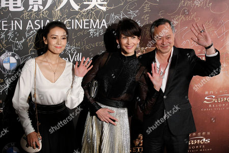 Stock Picture of Gao Yuanyuan, Sophie Marceau, Johnnie To From left, Chinese actress Gao Yuanyuan, French actress Sophie Marceau and Hong Kong director Johnnie To pose on the red carpet of the Asian Film Awards in Macau