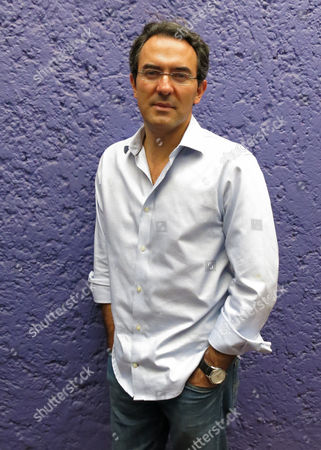 """Colombia's author Juan Gabriel Vasquez poses for a portrait in Mexico City. Vasquez unveils the chain effect provoked by the April 9, 1948 assassination of the Colombian politician Jorge Eliecer Gaitan in his novel """"La forma de las ruinas."""" Vasquez believes that the incident led to a period of violence in Colombia"""