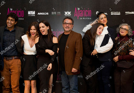 Tenoch Huerta, Iliana Fox, Ana de la Reguera, Moises Ortiz Urquidi, Erendira Ibarra, Liz Gallardo, Maria del Carmen Farias Director Moises Ortiz Urquidi, center, poses for pictures with actors, from left, Tenoch Huerta, Iliana Fox, Ana de la Reguera, Erendira Ibarra, Liz Gallardo, and Maria del Carmen Farias, during a press conference to promote the release of the film Las Aparicio, in Mexico City, . The film is based in the tv series about a family of all women