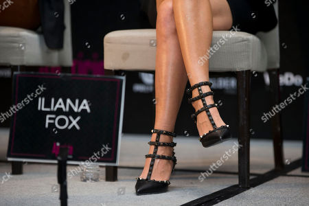 Actress Iliana Fox sits beside a sign with her name during a press conference to promote the release of the new film Las Aparicio, in Mexico City, . The film is based in the TV series about a family of all women