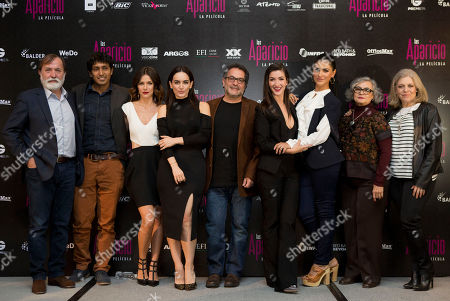 Epigmenio Ibarra, Tenoch Huerta, Iliana Fox, Ana de la Reguera, Moises Ortiz Urquidi, Erendira Ibarra, Liz Gallardo, Maria del Carmen Farias, Ana Celia Urquidi Cast and crew of the film Las Aparicio pose for pictures during a press conference to promote the release of the film, in Mexico City, . From left are producer Epigmenio Ibarra; actors Tenoch Huerta, Iliana Fox, and Ana de la Reguera; director Moises Ortiz Urquidi; actors Erendira Ibarra, Liz Gallardo and Maria del Carmen Farias; and producer Ana Celia Urquidi. The film is based in the TV series about a family of all women
