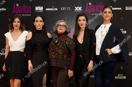 Actresses, from left, Iliana Fox, Ana de la Reguera, Maria del Carmen Farias, Erendira Ibarra, and Liz Gallardo pose for pictures during a press conference to promote the release of their film Las Aparicio, in Mexico City, . The film is based in the TV series about a family of all women
