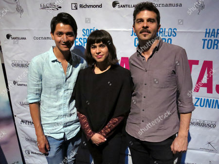 "The actor Armando Espitia, left, actress and writer Sofia Espinosa and director and writer Maz Zunino, right, of the Mexican movie ""Los Banistas"" pose for a portrait in Mexico City. The movie is a story about solidarity between a young woman who cannot study due to a strike at a university and an old salesman who is fired from his job. The movie premiers on March 31 in Mexico"