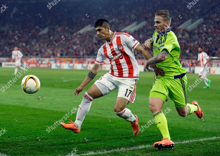 Alan Pulido, Alexander Buttner Olympiakos' Alan Pulido, left, fights for the ball with Anderlecht's Alexander Buttner during the Europa League round of 32 soccer match at the Georgios Karaiskakis stadium in the port of Piraeus, near Athens. A state official says that Mexican soccer star Alan Pulido has been kidnapped in the northern border state of Tamaulipas. Pulido is a forward for the Greek team Olympiacos and has made several appearances for Mexico's national team, though he wasn't called up for the upcoming Copa America tournament. The official says the 25-year-old player was kidnapped near his hometown of Ciudad Victoria on Sunday, May 29, 2016 after leaving a party