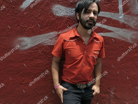 Stock Photo of Gabriel Lopez, of the band Sonido Gallo Negro, poses for a portrait in Mexico City. The Mexican band mixes cumbia with electronic music, rock and Latin rhythms like umbia peruana, mambo and danzon