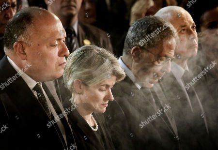 Stock Photo of Sameh Shoukry, Irina Bokova, Amr Moussa, Nabil Al-Araby From left to right, Egyptian Foreign Minister Sameh Shoukry, Director-General of UNESCO, Irina Bokova, former Secretary-General of the Arab League Amr Moussa, and Secretary General of the Arab League Nabil Al-Araby, pay their respects during the funeral of of former U.N. Secretary-General Boutros Boutros-Ghali, in Al-Boutrossiya Church, at the main Coptic Cathedral complex in Cairo, Egypt, . Boutros-Ghali, a veteran Egyptian diplomat who helped negotiate his country's landmark peace deal with Israel but then clashed with the United States when he served a single term as U.N. secretary-general, died Tuesday, Feb. 16, 2016, aged 93