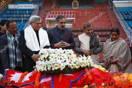 From left, India's National Security Advisor Ajit Doval, Communist Party of India (Marxist) Secretary Sitaram Yechury Congress party leader Anad Sharma, Janata Dal party leader Sharad Yadav and Indian Minister for External Affairs Sushma Swaraj, pay respect near the body of former prime minister Sushil Koirala, at the national stadium in Kathmandu, Nepal, . The former Nepalese prime minister and leader of the nation's largest political party, died in Kathmandu. He was 78
