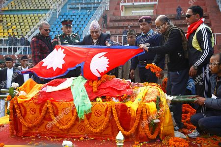 Khadga Prasad Sharma Oli Nepal's Prime Minister Khadga Prasad Sharma Oli, center, puts the Nepalese flag on the body of former prime minister Sushil Koirala, at the national stadium in Kathmandu, Nepal, . The former Nepalese prime minister and leader of the nation's largest political party, died in Kathmandu. He was 78