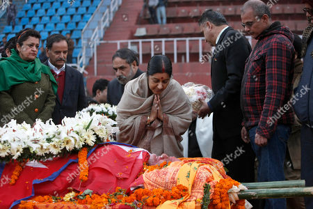 Sushma Swaraj Indian Minister for External Affairs Sushma Swaraj, center, pays respect near the body of former prime minister Sushil Koirala, at the national stadium in Kathmandu, Nepal, . The former Nepalese prime minister and leader of the nation's largest political party, died in Kathmandu. He was 78