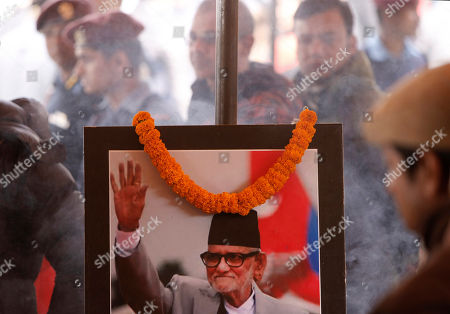 Sushil Koirala A portrait of former Nepalese Prime Minister, Sushil Koirala, is seen at the Nepali Congress central office as people queue up to pay their last respects in Kathmandu, Nepal, . Koirala, who was a key figure in the drafting and adoption of the country's new constitution in 2015, died Tuesday at the age of 78