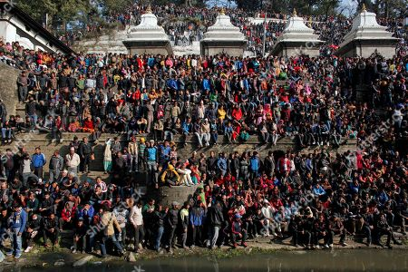 Nepalese people gather during the cremation of Nepalese prime minister Sushil Koirala, on the banks of the Bagmati River in Kathmandu, Nepal, . Koirala, who was a key figure in the drafting and adoption of the country's new constitution in 2015, died Tuesday at the age of 78