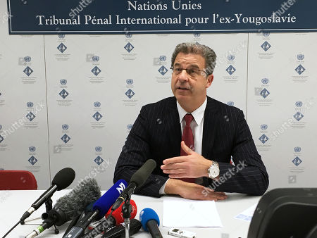 Serge Brammertz, Chief Prosecutor of the Yugoslav war crimes tribunal speaks during a press conference in The Hague, Netherlands, . In a sweeping defeat for U.N. prosecutors, the Yugoslav war crimes tribunal acquitted Serbian ultranationalist politician Vojislav Seselj on Thursday of all nine counts alleging that he was responsible for, or incited, atrocities by Serbian paramilitaries in the wars in Bosnia and Croatia in the early 1990's