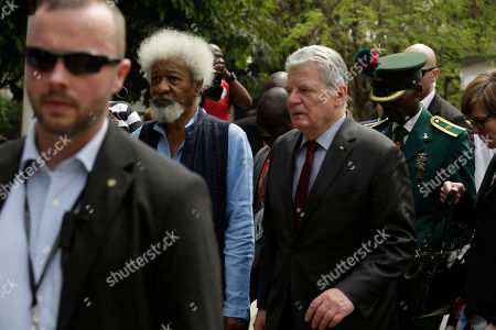 German's President Joachim Gauck, right, and Nigeria Nobel Laureate professor Wole Soyinka, left, walk during an official visit to freedom park in Lagos, Nigeria