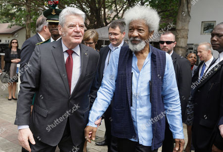 German's President Joachim Gauck, left, and Nigeria Nobel Laureate professor Wole Soyinka, walk together during an official visit to freedom park in Lagos, Nigeria