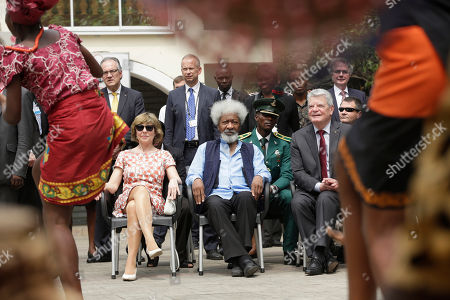 Germany President, Joachim Gauck, right, watches a traditional dance next to his wife Gerhild Gauck, left, and Nigerian playwright and poet Wole Soyinka during an official visit to Freedom Park in Lagos, Nigeria