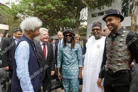 Germany's President Joachim Gauck, second left, talks with Nigeria Nobel Laureate professor Wole Soyinka, left, and businessmen during an official visit to Freedom Park in Lagos, Nigeria