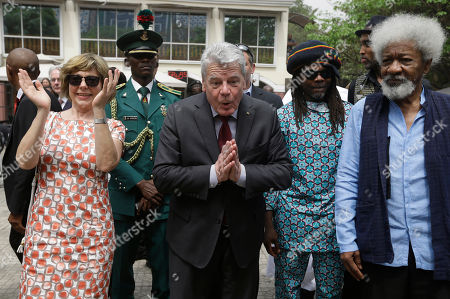German's President, Joachim Gauck, centre, gestures next to his wife Gerhild Gauck, left, and Nigeria Nobel Laureate professor Wole Soyinka, during an official visit to freedom park in Lagos, Nigeria