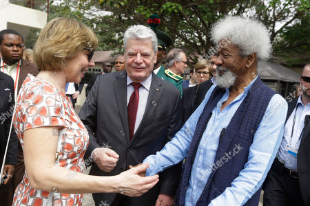 Stock Image of Germany President Joachim Gauck and his wife, Gerhild Gauck are welcomed by playwright and poet Wole Soyinka, of Nigeria, recipient of the 1986 Nobel Prize in Literature, during an official visit to Freedom Park in Lagos, Nigeria