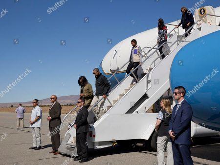 Barack Obama, Michelle Obama, Malia Obama, Sasha Obama, Marian Robinson President Barack Obama first lady Michelle Obama, followed by daughters Sasha and Malia and first lady's mother Marian Robinson arrive in San Carlos de Bariloche Airport, in Bariloche, Argentina