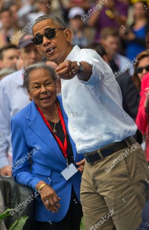 Barack Obama, Rachel Robinson President Barack Obama talks with Rachel Robinson, widow of baseball hall-of-famer Jackie Robinson, before taking his seat with Cuban President Raul Castro as they attend a exhibition baseball game between the Tampa Bay Rays and the Cuban National team at the Estadio Latinoamericano, in Havana, Cuba
