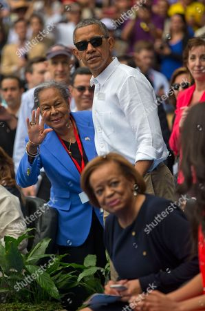 Barack Obama, Rachel Robinson, Marian Robinson President Barack Obama talks with Rachel Robinson, widow of baseball hall-of-famer Jackie Robinson, before taking his seat with Cuban President Raul Castro as they attend a exhibition baseball game between the Tampa Bay Rays and the Cuban National team at the Estadio Latinoamericano, in Havana, Cuba. The president's mother-in-law Marian Robinson is in the foreground