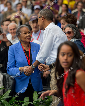 Barack Obama, Rachel Robinson President Barack Obama meets with Rachel Robinson, widow of MLB hall-of-famer Jackie Robinson, before taking his seat with Cuban President Raul Castro as they attend a exhibition baseball game between the Tampa Bay Rays and the Cuban National team at the Estadio Latinoamericano, in Havana, Cuba