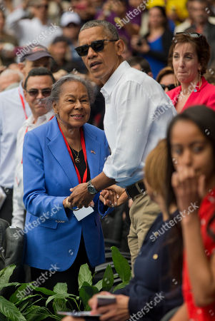 Barack Obama, Rachel Robinson President Barack Obama with Rachel Robinson, widow of MLB hall-of-famer Jackie Robinson, before taking his seat with Cuban President Raul Castro as they attend a exhibition baseball game between the Tampa Bay Rays and the Cuban National team at the Estadio Latinoamericano, in Havana, Cuba