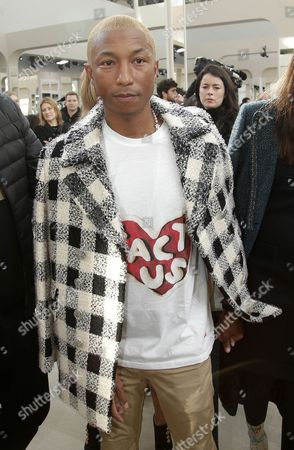 Pharell Williams arrives at Chanel's Fall-Winter 2016-2017 ready to wear fashion collection presented in Paris