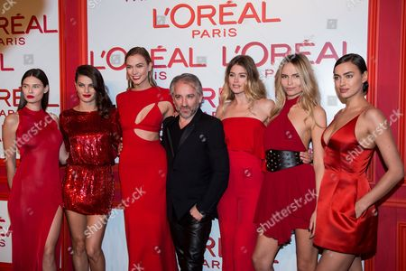 Cyril Chapuy, Bianca Balti, Isabeli Fontana, Karlie Kloss, Doutzen Kroes, Natasha Poly and Irina Shayk L'Oreal Paris president Cyril Chapuy, center, poses with, from left, Bianca Balti, Isabeli Fontana, Karlie Kloss, Doutzen Kroes, Natasha Poly and Irina Shayk for photographers upon arrival at the L'Oreal Red Obsession Party in Paris