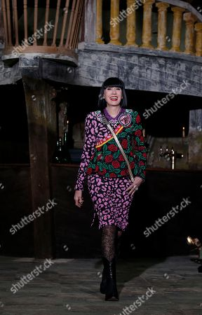 French fashion designer Chantal Thomas wears a creation for Manish Arora's Fall-Winter 2016-2017 ready to wear collection, in Paris