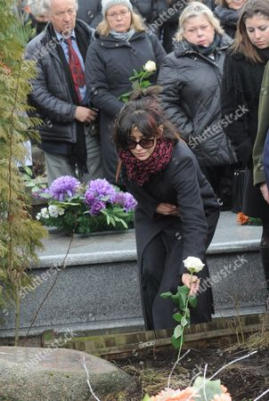 Sophie Marceau French actress Sophie Marceau, center, lays a flower on the grave of her former long-time partner, Polish film director Andrzej Zulawski, during his funeral in Gora Kalwaria, Poland