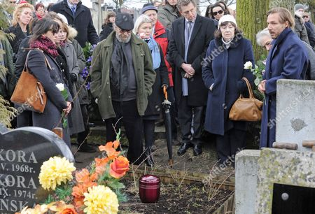 Sophie Marceau, Xawery Zulawski French actress Sophie Marceau, second left, stands at the grave of her former long-time partner, Polish film director Andrzej Zulawski, as his oldest son Xawery Zulawski, right, speaks during the funeral in Gora Kalwaria, Poland