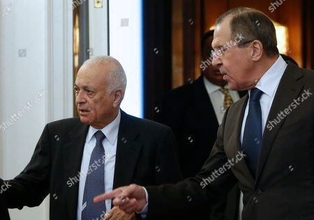 Sergey Lavrov, Nabil Elaraby Russian Foreign Minister Sergey Lavrov points the way for Arab League's Secretary-General Nabil Elaraby, left, during their meeting in Moscow, Russia, on