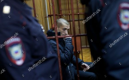 Petr Pavlensky Russian police officers guard as artist Petr Pavlensky sits in a cage in court room in Moscow, Russia, on . A Moscow court extended Pavlensky's detention until the beginning of April. The artist is known for his political art performances, including nailing his scrotum to the paving stones of the Red Square