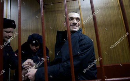 Petr Pavlensky Russian police officers escort artist Petr Pavlensky into a cage in court room in Moscow, Russia, on . A Moscow court extended Pavlensky's detention until the beginning of April. The artist is known for his political art performances, including nailing his scrotum to the paving stones of the Red Square