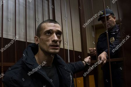 Petr Pavlensky Russian artist Petr Pavlensky speaks to journalists as he sits in a cage in court room in Moscow, Russia, . A Moscow court extended Pavlensky's detention until the beginning of April. The artist is known for his political art performances, including nailing his scrotum to the paving stones of the Red Square