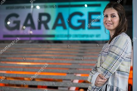 "Dasha Zhukova Dasha Zhukova, founder of the Garage Museum of Contemporary Art, poses in the museum in Moscow, Russia, . A new series of exhibits opens on March 17, 2016, at the Garage Museum of Contemporary Art in Moscow, including the parcel-sized replica concrete cube meant to house decayed nuclear waste by American artist Taryn Simon, inspired by Russian artist Kazimir Malevich's original early 1900's ""Black Square"" artwork"