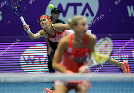Stock Image of Andrea Hlavackova, Lucie Hradecka Andrea Hlavackova of Czech Republic, left, returns the ball during the St. Petersburg Ladies Trophy-2016 tennis tournament doubles match with Lucie Hradecka of Czech Republic against Vera Dushevina of Russia and Barbora Krejcikova of Czech Republic in St.Petersburg, Russia