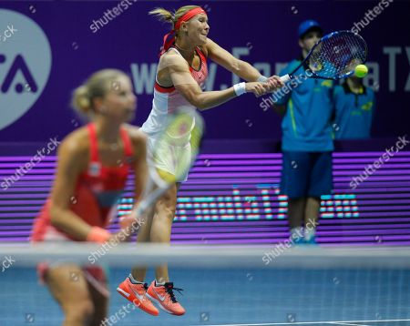 Andrea Hlavackova, Lucie Hradecka Andrea Hlavackova of Czech Republic, right, returns the ball during the St. Petersburg Ladies Trophy-2016 tennis tournament doubles match with Lucie Hradecka of Czech Republic against Vera Dushevina of Russia and Barbora Krejcikova of Czech Republic in St.Petersburg, Russia