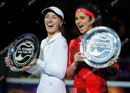 Martina Hingis, Sania Mirza Martina Hingis of Switzerland, left, and with Sania Mirza of India, celebrate their victory in the St. Petersburg Ladies Trophy-2016 tennis tournament doubles final match against Vera Dushevina of Russia and Barbora Krejcikova of Czech Republic in St.Petersburg, Russia