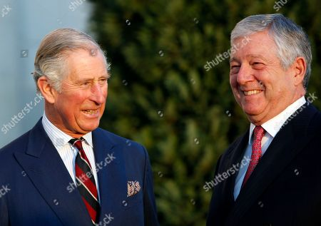 Heir to Serbia's defunct throne, Crown Prince Aleksandar Karadjordjevic, right, smiles during talks with Britain's Prince Charles in the Royal Palace in Belgrade, Serbia, . The British royal couple are on an official visits to Croatia, Serbia, Montenegro and Kosovo
